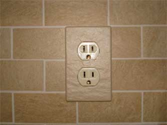 Magnetic ceramic electrical outlet cover