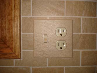 Magnetic ceramic switch and outlet cover plate