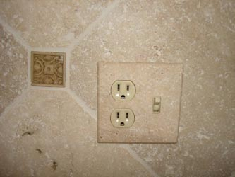 Tumbled travertine switch plate