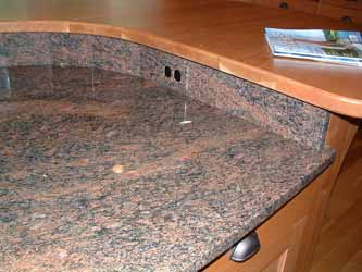 An installed granite electrical outlet cover