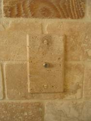 Installed travertine stone cable jack plate