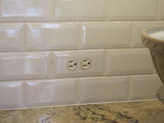 Close up of a tiled in subway tile switch plate cover